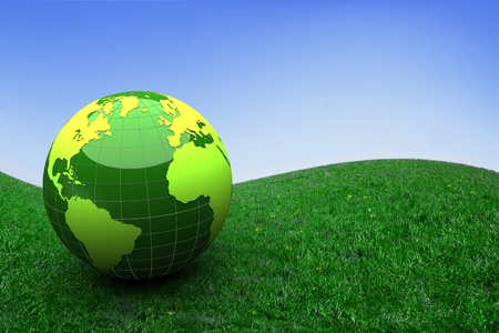 3d green globe on grass - ecology concept photo