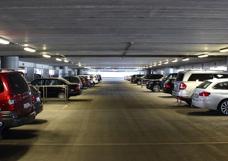 standstill: Aisle with cars in indoor parkinglot at airport Editorial