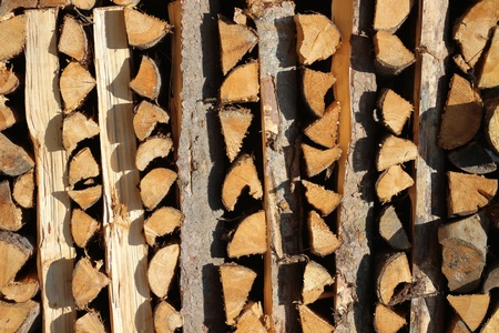 orderly: Close up on vertical placed pile of fire wood in vertical