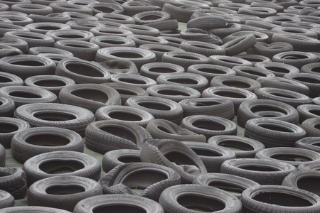 stockpiling: Old tires used as cover for a heap of lime at a farm