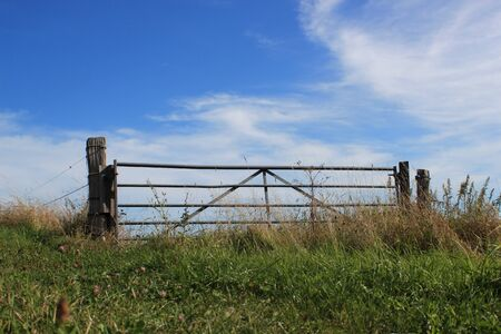 Field gate on top of a hill - a gate to the sky photo