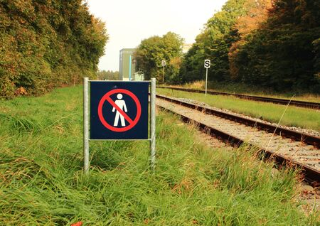 Sign prohibits access to a railway area