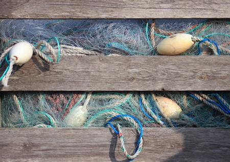 Blue industry fishing nets in old wooden storage box photo
