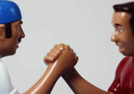 Two characters in an arm wrestling fight photo