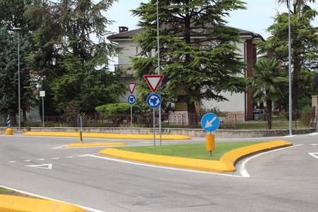 Roundabout with yellow curb and green grass in summer Stock Photo - 25917907