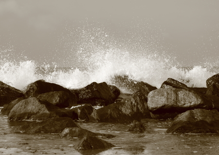 turmoil: Silent water behind large rocks at beach