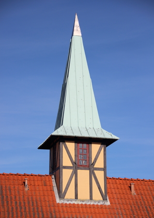 verdigris: Half-timbering tower with verdigris roof on red tile building Stock Photo