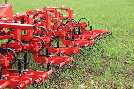 harrow: Harrow in green crop field after rainfall