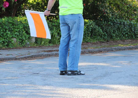 Traffic guide with flag at running race