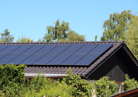 solarpanel: Solar collector on house roof with blue sky