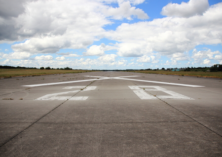 Airplane runway asphalt with number and cross photo
