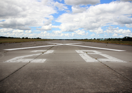 airfield: Closeup on runway number at airfield Stock Photo