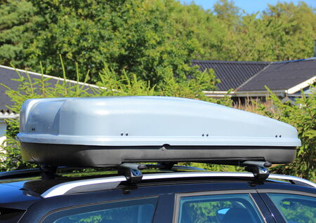 box tree: Roof box on car with tree background Stock Photo