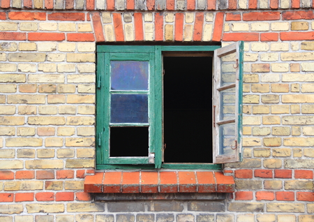 open window: Open window with green frame and missing glass