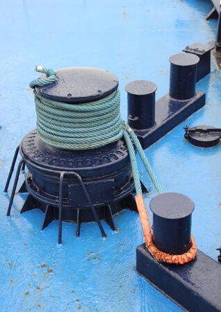 ship anchor: Anchor winch with rope on blue ship deck Stock Photo