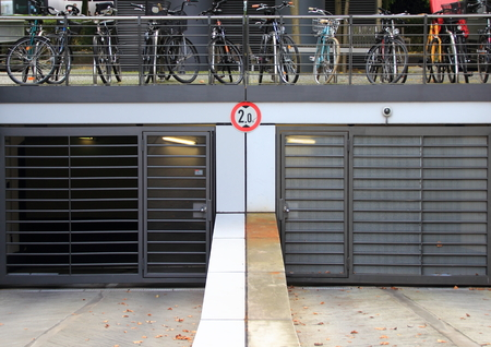 citylife: City parkinglot entrance with bicycles on top