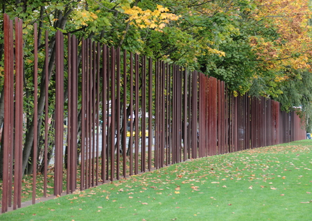 dictatorship: Berlin wall memorial Germany with iron markers  in autumn