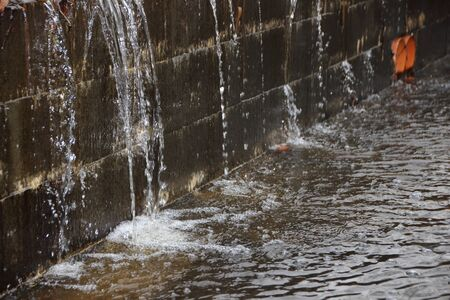 dyke: Embankment under Water Pressure with Water Spraying and creating small waterfall Stock Photo