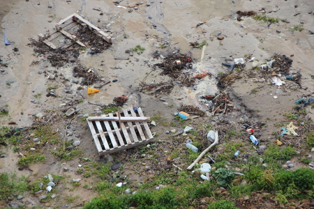 birdseye: Stranded Garbage on Beach after Storm Birdseye Perspective Stock Photo