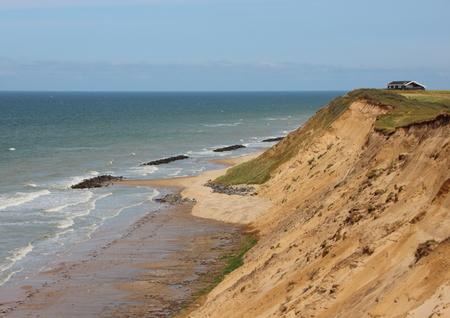 groyne: Landscape of Sandy Cliffs at Ocean and Summer House near Edge