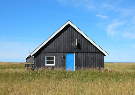 summer house: Summer House with Black Wood Planks and Center Blue Door