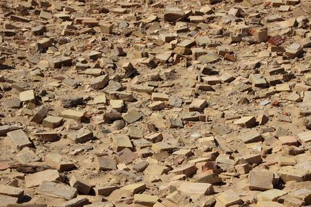 rebuild: Birdseye on Yellow Clay Building Brick Tiles in Sand