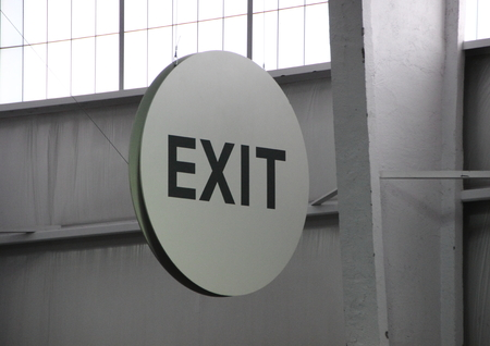 exit sign: Round Exit Sign in Industrial Environment with Back light and Down light Stock Photo