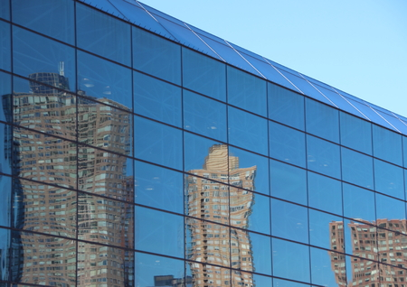 fragmented: Reflection of Urban Fragmented Skyscrapers in Blue Window Facade