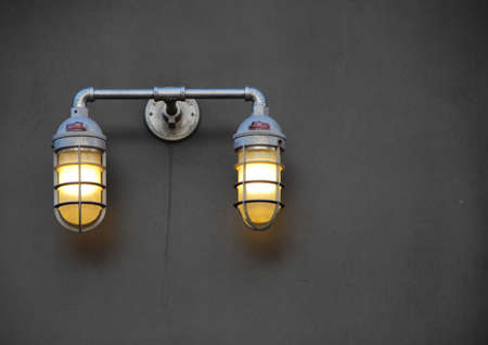 metal grid: Reinforced City Lamps with Metal Grid on Dark Brown Wall Outside