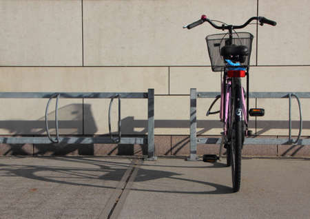 rack mount: Single Bicycle in Steel Bike Mounted Parking Rack with Shadow Stock Photo