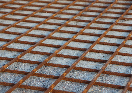 strong foundation: Rusty Metal Foundation Construction Grid on Sand Background