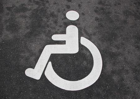handicap sign: Isolated White Handicap Disabled Sign on Black Asphalt