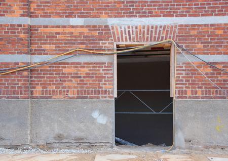 door opening: Empty Door Opening with Wires and Materials at Building Site