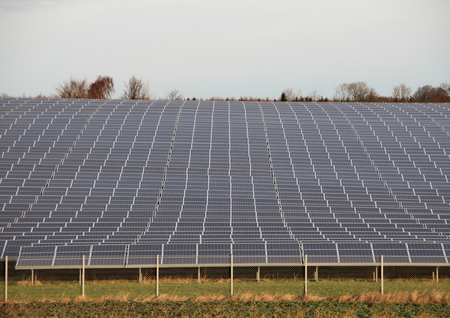 solarcell: Sun Solar Industrial Plant with Fence Grass and Horizon
