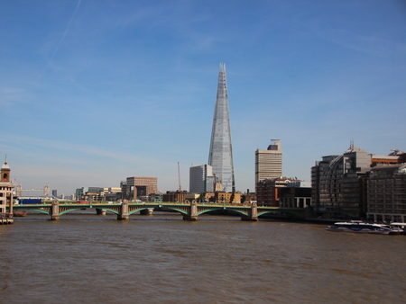 river thames: River Thames with The Shard Tower in Blue Sky Background Editorial