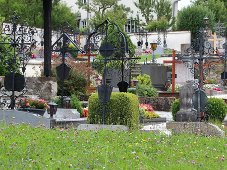 final thoughts: Peaceful Catholic Graveyard in Austria with Ornamented Iron Headstones