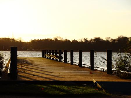 Wooden Pier at Lake in Morning Light Reklamní fotografie