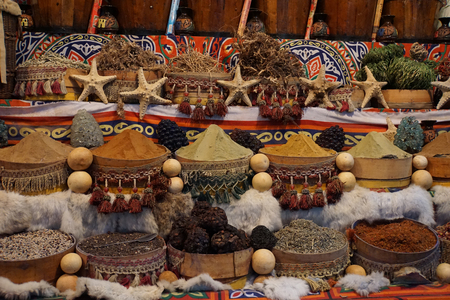 market in egypt with colorful spice and tea photo