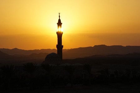 sunset over mosque in egypt town of el quesir