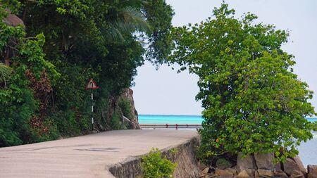 praslin: tropical beach road on praslin island Stock Photo
