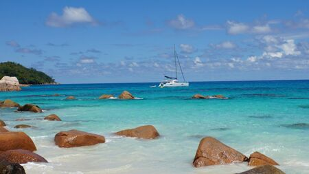 catamaran: granite rocks and catamaran on seychelles