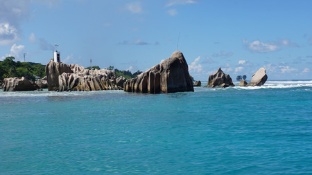 la digue: lighthouse on the rocks on la digue