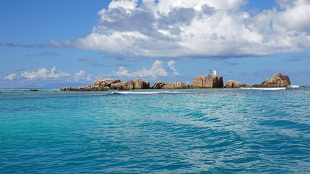 digue: lighthouse on the rocks on la digue