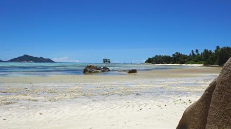 digue: bizarre granite rocks on tropical beachon la digue