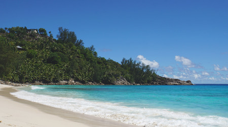 yearning: white sand on tropical beachon the seychelles