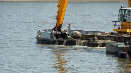 dredging: river digging on german river elbe in hamburg Stock Photo