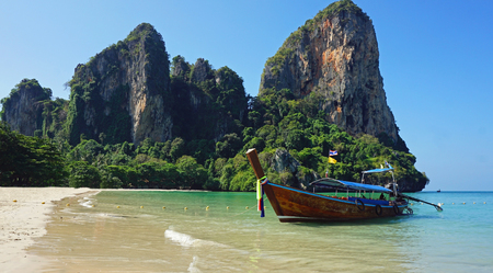 traditional thai longtail boat on railey beach