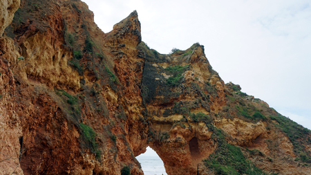stone grotto on the algarve coast Stock Photo