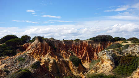 red iron rocks on the algarve coast in portugal Stock Photo