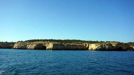 amazing algarve coastline taken from the sea